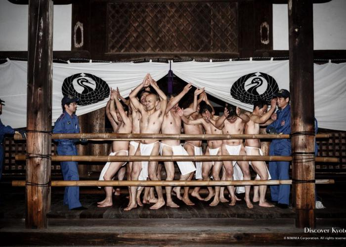 Naked men are dancing merrily on stage in the cold winter night