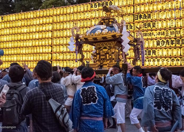 Mikoshi parade in front of thousands of golden lanterns.