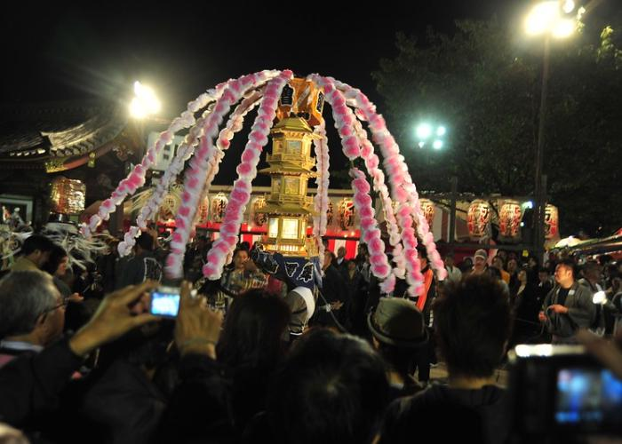 Mikoshi covered in cherry blossom parade.