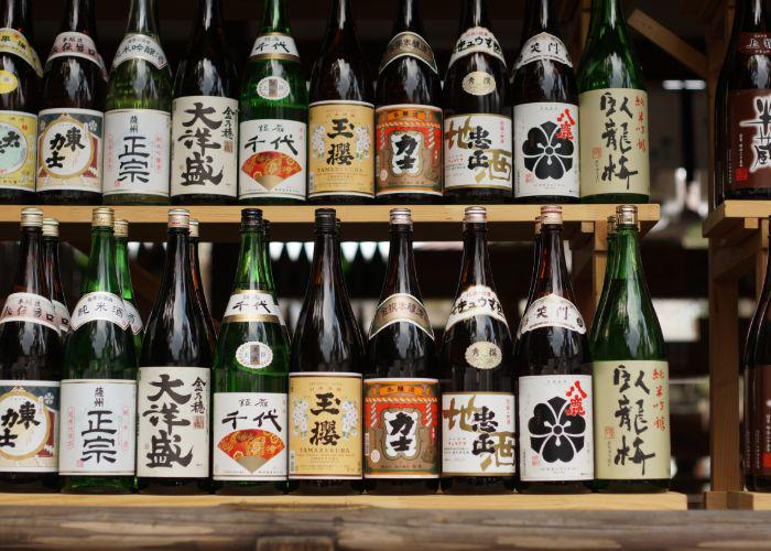 Sake bottles lines up on a shelf