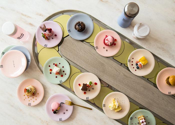 Desserts on conveyor belt.