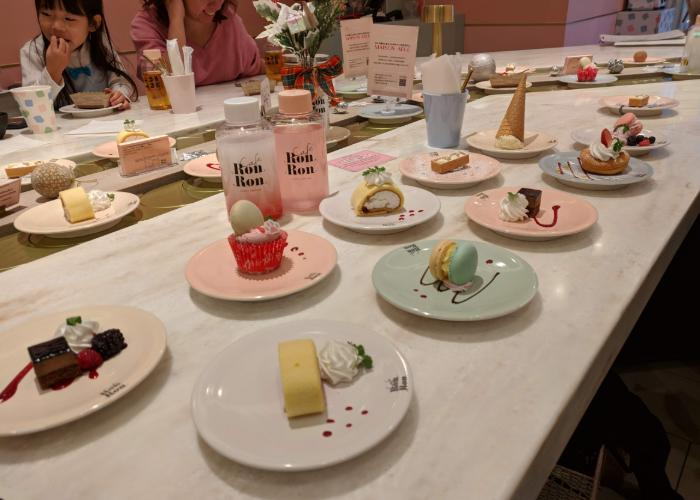 Colorful desserts on table.
