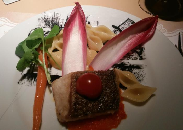"""Alice in Wonderland inspired fish dish garnished with """"rabbit ears"""""""