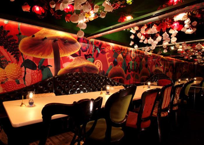 Seating at Alice in a Labyrinth themed restaurant in Ginza, Tokyo