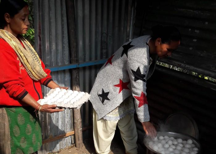 Two women boiling eggs at Notre Dame in rural Darjeeling