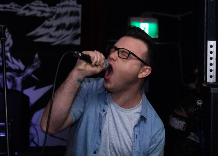 A man singing on microphone.