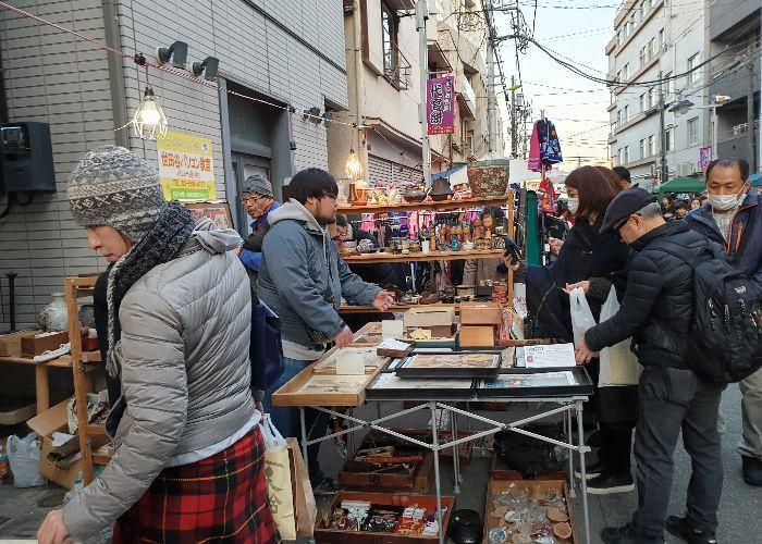 Crowds of people gather around home goods at Boroichi Market