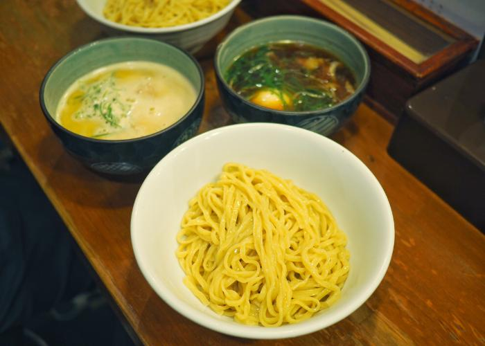 Bowl of tsukemen ramen with thick curly noodles from Kogaryu Seimen, a ramen shop in Kobe