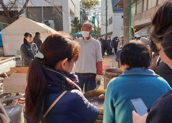 Man selling sweet potatoes, satsumaimo
