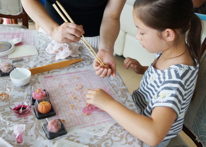 Little girl making Japanese wagashi, a vegan traditional sweet
