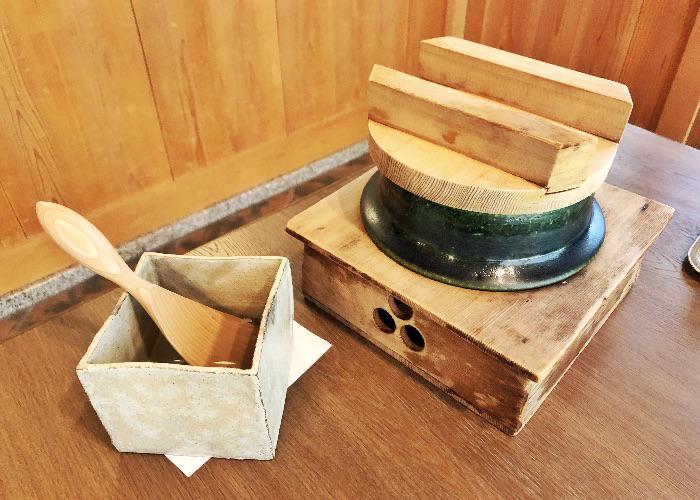 Earthen clay pot for cooking rice at Komago restaurant
