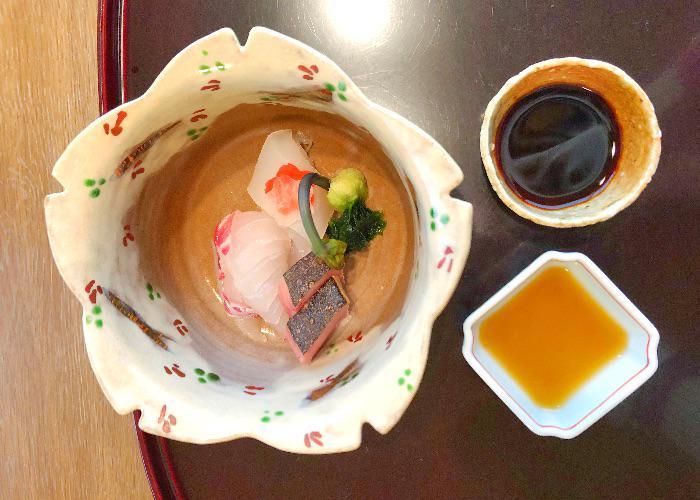 A beautiful sakura-shaped dish containing sashimi from Komago, a 3-star Michelin Restaurant in Hyogo