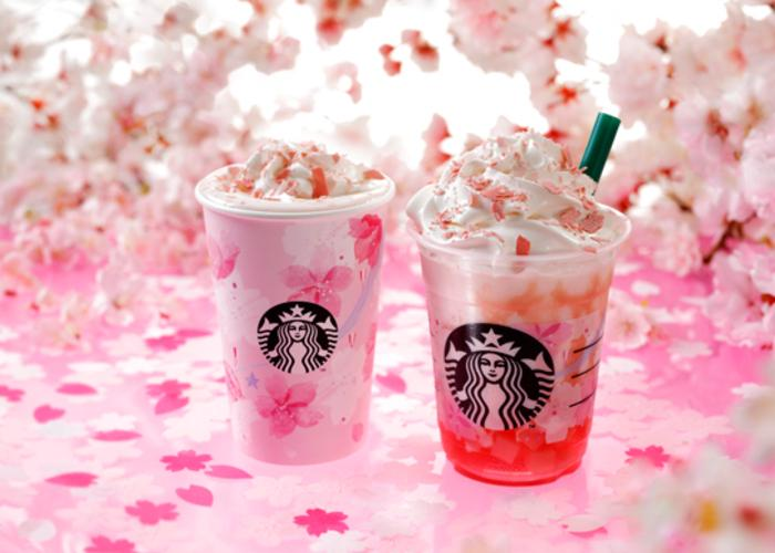 Promotional image for Starbucks Sakura Latte and Frappuccino in Japan, with two drinks against a backdrop of cherry blossom petals
