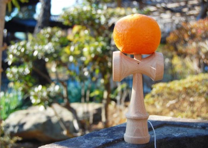 Traditional Japanese game, Kendama, including a ball speared on a stick