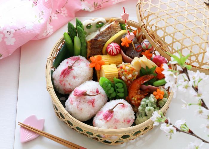 Sakura onigiri bento box, made with sakura featuring pickled cherry blossoms