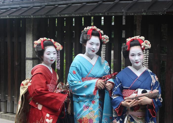 Geisha dressed in colorful kimono