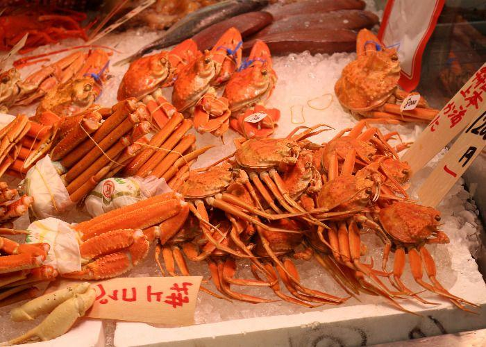 Big crabs and other shellfish on ice for sale