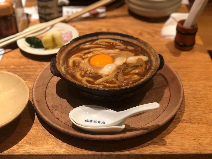 Miso Nikomi Udon, a Nagoya red miso dish of udon noodles topped with a raw egg