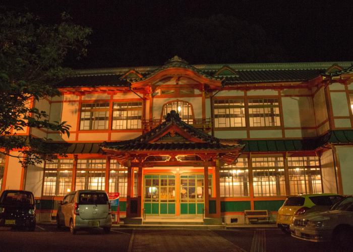 Facade of Takeo Onsen at night