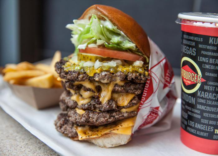 Enormous burger from Fatburger, dripping in cheese with a side of fries