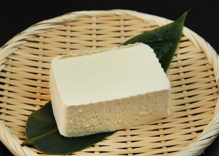 Momen tofu laid out on a bamboo zaru