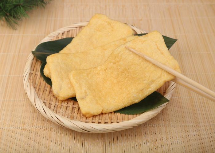 Aburaage fried tofu laid out on a bamboo zaru