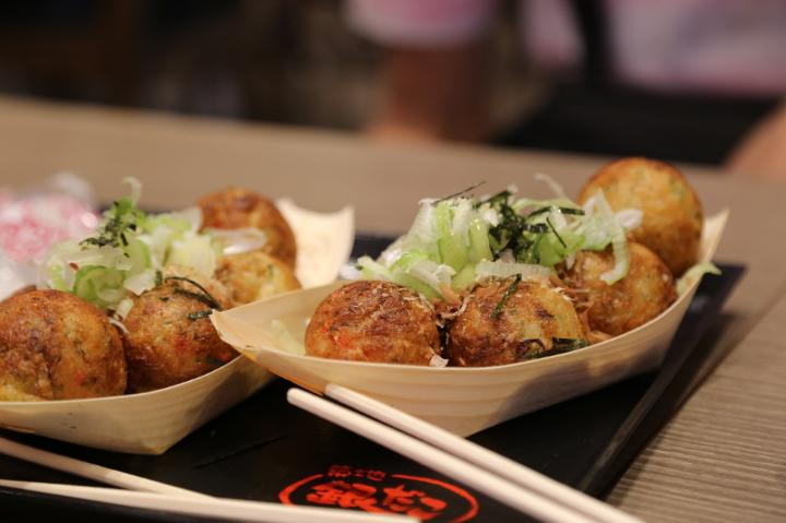 Two servings of takoyaki from Japanese takoyaki chain, Gindaco