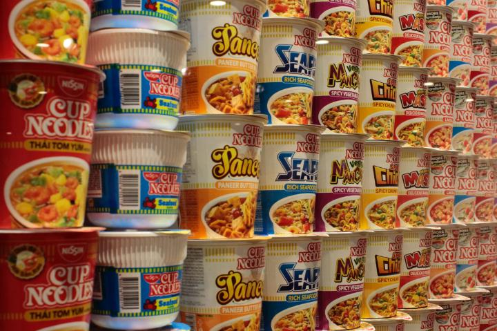 A long wall of Cup Noodles featuring seafood noodles and chicken Cup Noodles