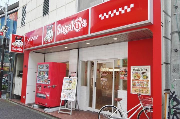Red exterior of ramen chain Sugakiya, bike