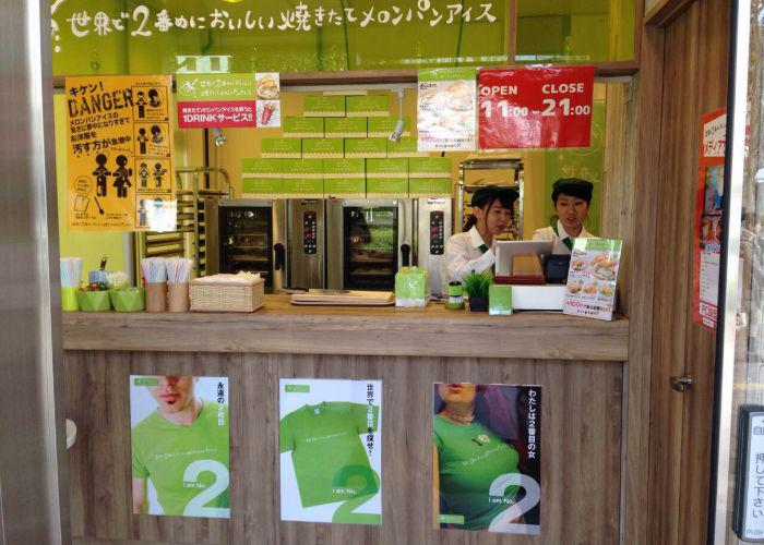 In the storefront of Melon Pan Ice, two employees are getting ready to serve customers.