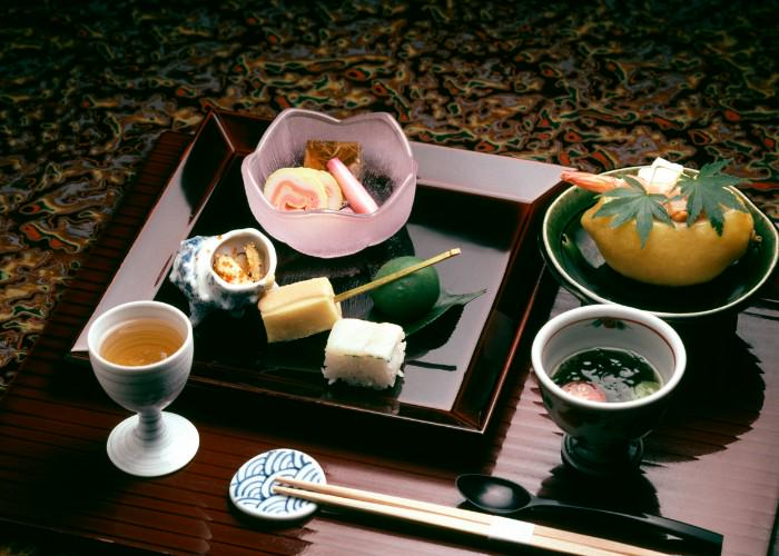 Kaiseki Ryori, the traditional Japanese banquet-style meal. A tray holding a variety of seasonal Japanese dishes