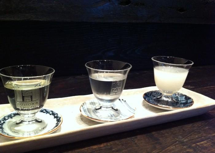 3 glass sake cups filled with nihonshu from Fujioka Shuzo
