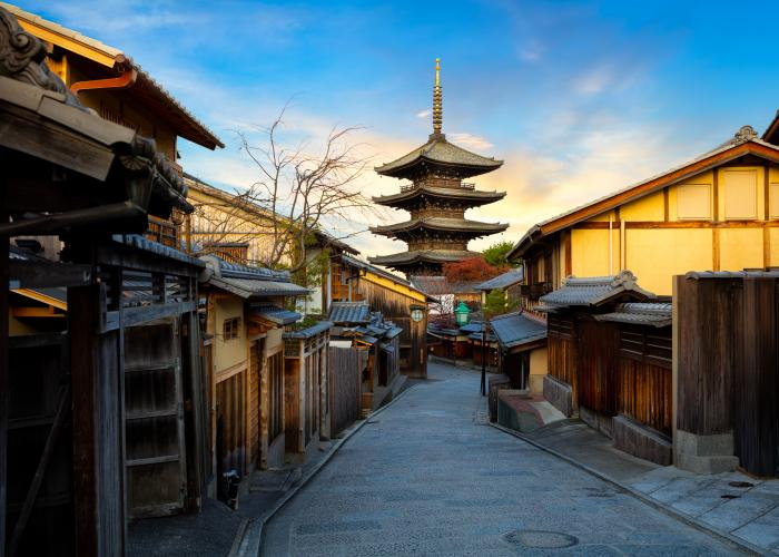 Street in Higashiyama, Kyoto, with traditional architecture and blue skies