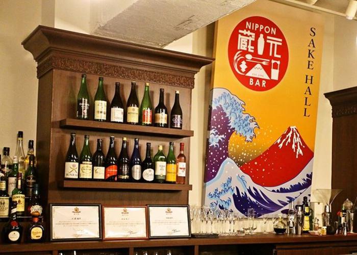 Wall of sake at SAKE HALL HIBIYA BAR, a nihonshu bar in Tokyo