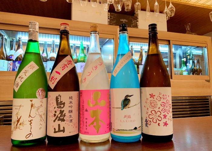 Line-up of sake bottles at Akita Pure Rice Sake Bar