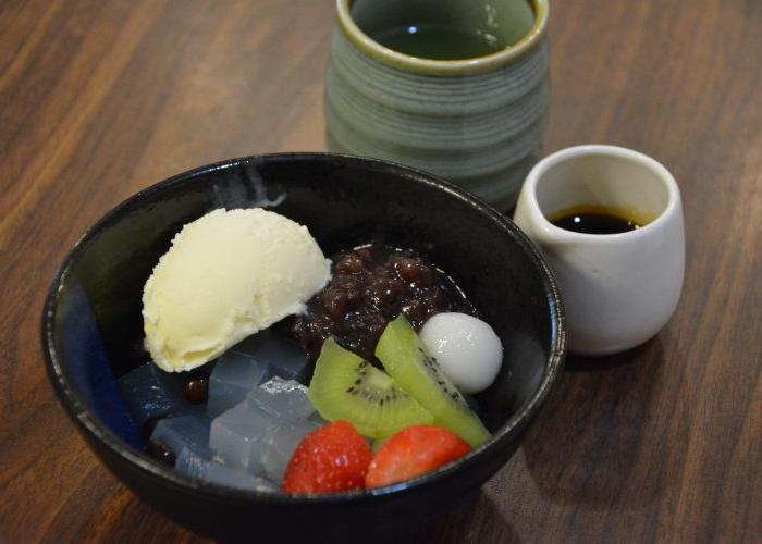 Anmitsu, a Japanese dessert with fruits, jelly, ice cream, red bean, and mochi ball
