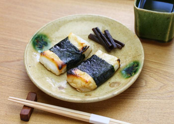 Isobe Maki Mochi, wrapped in nori and drizzled with soy sauce