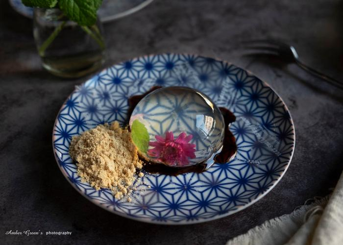 "The ""Raindrop Cake,"" Mizu Shingen Mochi on a Japanese plate"