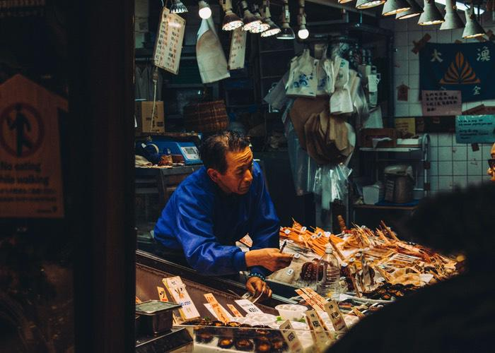 A picture of a seller at Nishiki Market in Kyoto