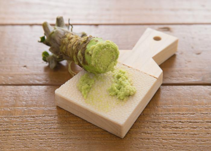 Authentic Japanese wasabi root grated on a sharkskin grater