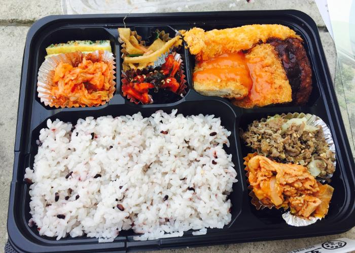 Bento from konbini with rice and other colorful vegetable dishes