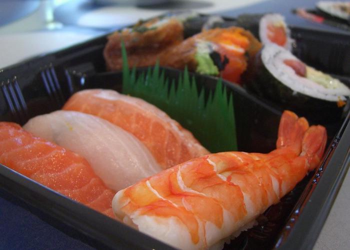 Bento with nigiri sushi and sushi rolls