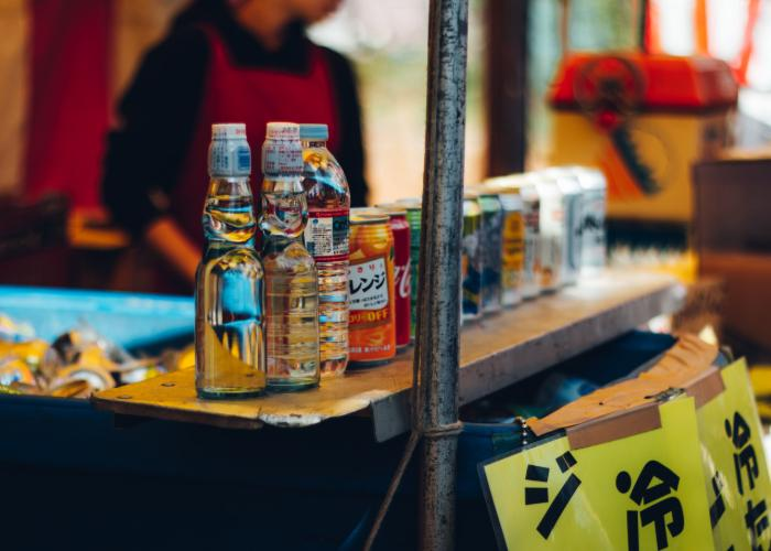 A stall sells Ramune, a popular drink in Japan, in a distinct bottle