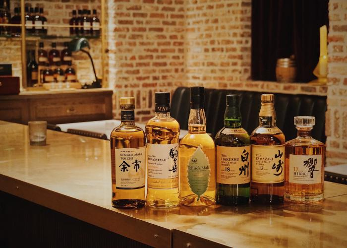 Bottles of Japanese whisky, a popular alcohol in Japan, lined up on a bar counter