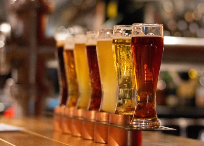 Pints of Japanese craft beer lined up on a bar couner