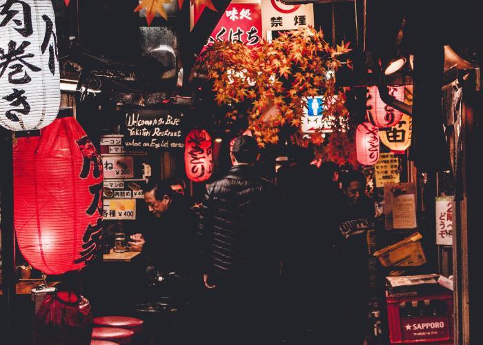 Shinjuku after dark with lanterns glowing