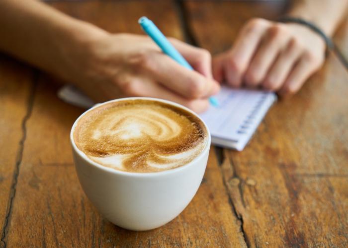 Beautifully swirled latte, cup of coffee