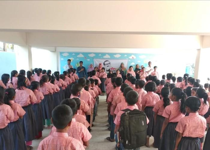 Children in a classroom in Bangladesh wearing neat school uniforms donated through byFood's Food for Happiness program