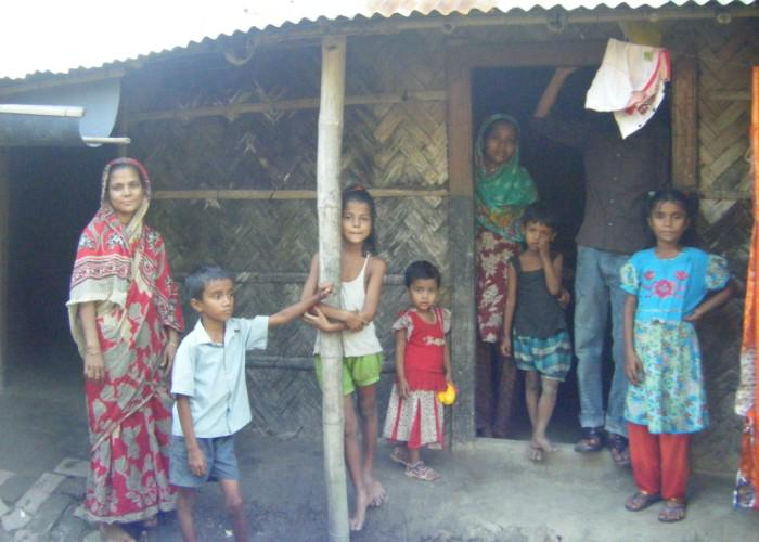 Children in Bangladesh stand outside a house