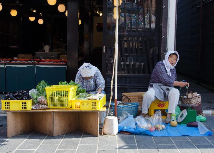 Two women selling vegetables at Wajima Asaichi Morning Market in Sendai